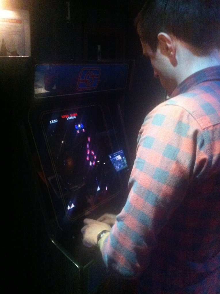 Ian attempts to beat my high score on Galaga.